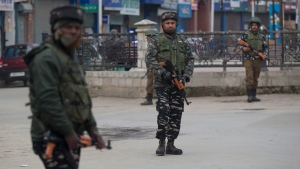 Indian paramilitary soldiers stand guard in a closed market in Srinagar, Indian controlled Kashmir, Saturday, Feb. 23, 2019. Police have arrested at least 200 activists seeking the end of Indian rule in disputed Kashmir, officials said Saturday, escalating fears among already wary residents that a sweeping crackdown could touch off renewed anti-India protests and clashes. (AP Photo/ Dar Yasin)
