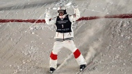 Mikael Kingsbury, of Canada, celebrates as he lands his jump during the men's skiing moguls world championships Friday, Feb. 8, 2019, in Park City, Utah. (AP Photo/Rick Bowmer)