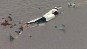 This image taken from video provided by KRIV FOX 26 shows the scene of a cargo plane crash on Saturday, Feb. 23, 2019 in Trinity Bay, just north of Galveston Bay and the Gulf of Mexico in Texas.  Lynn Lunsford with the Federal Aviation Administration did not immediately know the status of the people aboard and the Chambers County Sheriff's Office could not immediately be reached for comment.  (KRIV FOX 26 via AP)