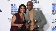 "Regina King, winner of the award for best supporting female, left, and Barry Jenkins, winner of best director and best feature, all for ""If Beale Street Could Talk,"" pose in the press room at the 34th Film Independent Spirit Awards on Saturday, Feb. 23, 2019, in Santa Monica, Calif. (Photo by Richard Shotwell/Invision/AP)"