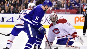 Toronto Maple Leafs left wing Zach Hyman (11) looks for a rebound as Montreal Canadiens goaltender Carey Price (31) makes a save during second period NHL hockey action in Toronto on Saturday, Feb. 23, 2019. THE CANADIAN PRESS/Frank Gunn