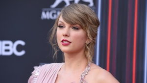 FILE - In this May 20, 2018 file photo, Taylor Swift arrives at the Billboard Music Awards at the MGM Grand Garden Arena, in Las Vegas.  (Photo by Jordan Strauss/Invision/AP, File)