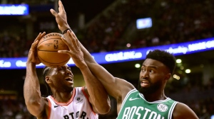 Boston Celtics guard Jaylen Brown (7) fouls Toronto Raptors forward Kawhi Leonard (2) during second half NBA basketball action in Toronto on Tuesday, Feb. 26, 2019. THE CANADIAN PRESS/Frank Gunn