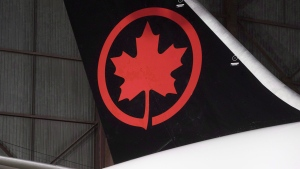 The tail of the newly revealed Air Canada Boeing 787-8 Dreamliner aircraft is seen at a hangar at the Toronto Pearson International Airport in Mississauga, Ont., Thursday, February 9, 2017. THE CANADIAN PRESS/Mark Blinch