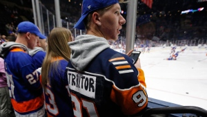 A New York Islanders fan lets everyone know his opinion of former Islanders captain John Tavares, now with the Toronto Maple Leafs, before an NHL hockey game between the teams Thursday, Feb. 28, 2019, in Uniondale, N.Y. (AP Photo/Kathy Willens)