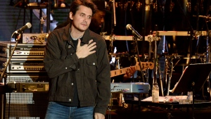 In this Oct. 31, 2018 file photo, John Mayer gestures to the crowd during the tribute event Mac Miller: A Celebration of Life at the Greek Theatre in Los Angeles. Mayer is launching a foundation focused on improving the health of veterans through scientific research. The singer on Friday, March 1, 2019 announced The Heart and Armor Foundation, which plans to focus on veterans with post-traumatic stress and meeting the emerging needs of women veterans. (Photo by Amy Harris/Invision/AP, File)