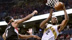 Toronto Raptors forward Kawhi Leonard (2) reaches for the hoop as Portland Trail Blazers forward Maurice Harkless (4) defends during second half NBA basketball action in Toronto on Friday, March 1, 2019. THE CANADIAN PRESS/Frank Gunn