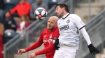 Toronto FC midfielder Michael Bradley (4) battles Philadelphia Union midfielder midfielder Ilsinho (25) for a header in the first half of an MLS soccer match in Chester, Pa., Saturday, March 2, 2019. (AP Photo/Rich Schultz)