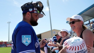 Toronto Blue Jays' Rowdy Tellez signs autographs for fans before a spring training baseball game against the Philadelphia Phillies, Thursday, Feb. 28, 2019, in Dunedin, Fla. (AP Photo/Lynne Sladky)