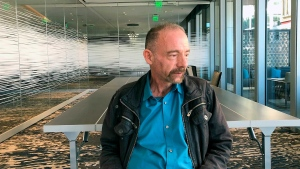 "Timothy Ray Brown poses for a photograph, Monday, March 4, 2019, in Seattle. Brown, also known as the ""Berlin patient,"" was the first person to be cured of HIV infection, more than a decade ago. (AP Photo/Manuel Valdes)"