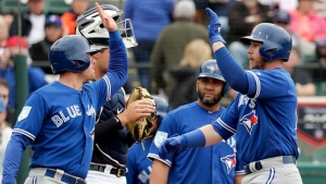 Toronto Blue Jays' Justin Smoak, right, high-fives teammate Billy McKinney after hitting a 3-run home in the first inning against the Detroit Tigers of a spring training baseball game, Tuesday, March 5, 2019, in Lakeland, Fla. (AP Photo/John Raoux)