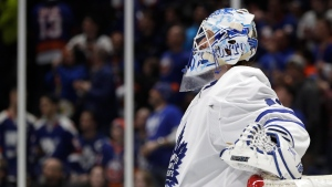 Toronto Maple Leafs goaltender Garret Sparks looks at a video replay on a screen above the ice after New York Islanders center Casey Cizikas scored a goal during the second period of an NHL hockey game, Thursday, Feb. 28, 2019, in Uniondale, N.Y. (AP Photo/Kathy Willens)