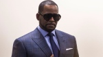 Musician R. Kelly arrives at the Daley Center for a hearing in his child support case at the Daley Center, Wednesday, March 6, 2019, in Chicago. (Ashlee Rezin/Chicago Sun-Times via AP)