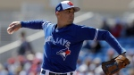 Toronto Blue Jays starting pitcher Aaron Sanchez delivers to the Philadelphia Phillies during the first inning of a spring training baseball game Wednesday, March 6, 2019, in Dunedin, Fla. (AP Photo/Chris O'Meara)