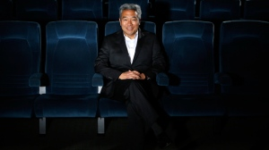 In this Feb. 6, 2013, file photo, Kevin Tsujihara, poses for photos in a screening room at the Warner Bros. Studios in Burbank, Calif. WarnerMedia is investigating claims that Warner Bros. chairman and CEO Tsujihara promised acting roles in exchange for sex as detailed in The Hollywood Reporter, Wednesday, March 6, 2019. (AP Photo/Jae C. Hong, File)
