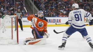 Toronto Maple Leafs' John Tavares (91) watches the puck go past Edmonton Oilers' goalie Anthony Stolarz (32) during first period NHL action in Edmonton on Saturday, March 9, 2019. THE CANADIAN PRESS/Jason Franson