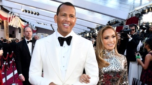 FILE - In this Sunday, Feb. 24, 2019, file photo, Alex Rodriguez, left, and Jennifer Lopez arrive at the Oscars at the Dolby Theatre in Los Angeles. Rodriguez and Lopez are engaged. The couple posted an Instagram photo of their hands with a massive engagement ring on Lopez's ring finger. (Photo by Charles Sykes/Invision/AP, File)