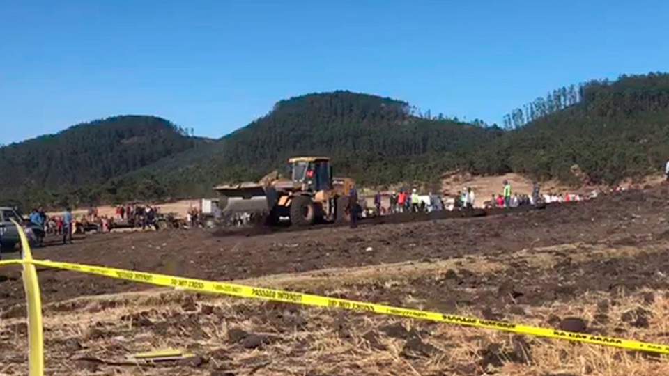 In this image made from video, rescuers use a mechanical digger at the scene of an Ethiopian Airlines flight that crashed shortly after takeoff at the scene at Hejere near Bishoftu, or Debre Zeit, some 50 kilometers (31 miles) south of Addis Ababa, in Ethiopia Sunday, March 10, 2019. The Ethiopian Airlines flight crashed shortly after takeoff from Ethiopia's capital on Sunday morning, killing all 157 on board, authorities said, as grieving families rushed to airports in Addis Ababa and the destination, Nairobi. (AP Photo/Yidnek Kirubel)