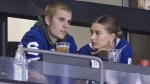 Justin Bieber watches alongside his wife Hailey Baldwin, right, during NHL hockey action between the Philadelphia Flyers and the Toronto Maple Leafs, in Toronto on Saturday, Nov. 24, 2018. (THE CANADIAN PRESS / Chris Young)