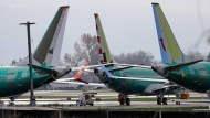 Boeing 737 MAX 8 planes are parked near Boeing Co.'s 737 assembly facility in Renton, Wash. on Nov. 14, 2018. (Ted S. Warren / AP Photo)