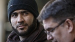 Former Guantanamo Bay prisoner Omar Khadr and his lawyer Nate Whitling speak with media outside the courthouse in Edmonton on Tuesday, February 26, 2019. THE CANADIAN PRESS/Jason Franson