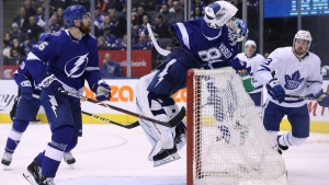 Tampa Bay Lightning defenceman Braydon Coburn (55) watches as Tampa Bay Lightning goaltender Andrei Vasilevskiy (88) leaps to make a stop against the Toronto Maple Leafs during third period NHL hockey action in Toronto on Monday, March 11, 2019. THE CANADIAN PRESS/Cole Burston