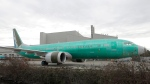 A Boeing 737 MAX 8 being built for Oman Air sits parked at Boeing Co.'s Renton Assembly Plant, Monday, March 11, 2019, in Renton, Wash.  (AP Photo/Ted S. Warren)