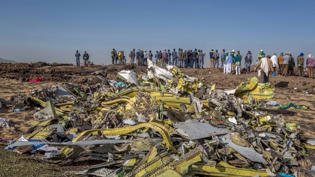 Wreckage is piled at the crash scene of an Ethiopian Airlines flight crash near Bishoftu, or Debre Zeit, south of Addis Ababa, Ethiopia, Monday, March 11, 2019.  A spokesman says Ethiopian Airlines has grounded all its Boeing 737 Max 8 aircraft as a safety precaution, following the crash of one of its planes in which 157 people are known to have died. (AP Photo/Mulugeta Ayene)