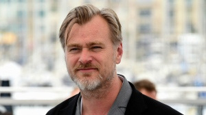 "FILE - In this May 12, 2018 file photo, director Christopher Nolan poses for photographers during a photo call for ""Rendezvous with Christopher Nolan"" at the 71st international film festival, Cannes, southern France.  (Photo by Arthur Mola/Invision/AP, File)"