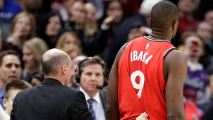 Toronto Raptors' Serge Ibaka (9), from Republic of Congo, is escorted off the court after getting ejected in the second half of an NBA basketball game against the Cleveland Cavaliers, Monday, March 11, 2019, in Cleveland. The Cavaliers won 126-101. (AP Photo/Tony Dejak)