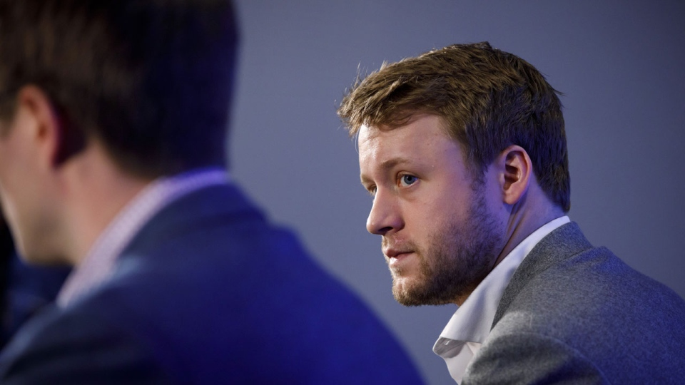 Toronto Maple Leafs defenceman Morgan Rielly looks on alongside General Manager Kyle Dubas as they address an NHL investigation into an alleged slur during last night's game against the Tampa Bay Lightning, in Toronto, Tuesday, March 12, 2019. THE CANADIAN PRESS/Cole Burston