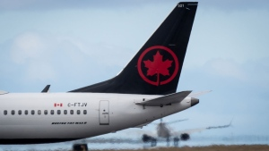 An Air Canada Boeing 737 Max 8 aircraft departing for Calgary taxis to a runway at Vancouver International Airport in Richmond, B.C., on Tuesday, March 12, 2019. THE CANADIAN PRESS/Darryl Dyck
