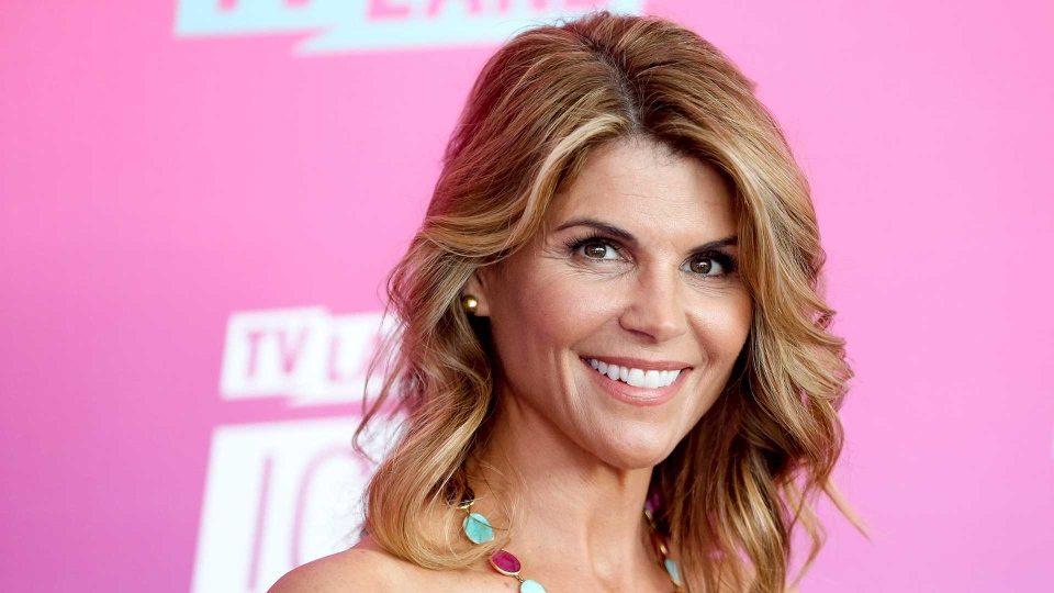 In this April 10, 2016 file photo, actress Lori Loughlin arrives at the TV Land Icon Awards in Santa Monica, Calif. Felicity Huffman and Loughlin have worked steadily as respected actresses and remained recognizable if not-quite-A-list names for decades. (Photo by Rich Fury/Invision/AP, File)