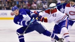 Toronto Maple Leafs right wing Kasperi Kapanen (24) and Montreal Canadiens left wing Paul Byron (41) battle for the puck during second period NHL hockey action in Toronto on Saturday, Feb. 23, 2019. THE CANADIAN PRESS/Frank Gunn