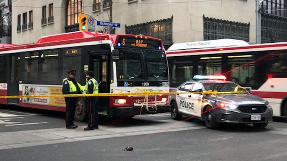 The scene of a collision near Bay and Richmond streets on March 13, 2019 is seen. (CP24 / Cristina Tenaglia)