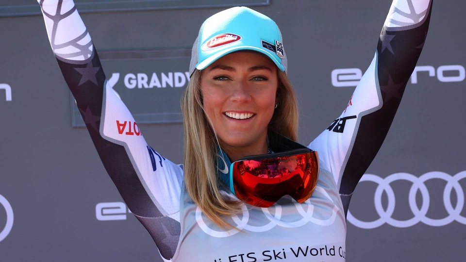 United States' Mikaela Shiffrin celebrate on podium after the women's super G race at the alpine ski World Cup finals, in Soldeu, Andorra, Thursday, March 14, 2019. (AP Photo/Alessandro Trovati)