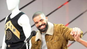Canadian rap star Drake reacts during a press conference where his OVO uniforms were unveiled ahead of NBA basketball action between the Toronto Raptors and Detroit Pistons in Toronto on Wednesday, January 17, 2018. THE CANADIAN PRESS/Frank Gunn