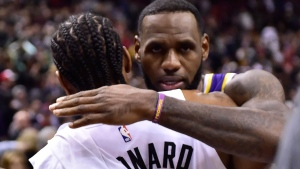 Los Angeles Lakers forward LeBron James (23) and Toronto Raptors forward Kawhi Leonard (2) greet each other after NBA basketball action in Toronto on Thursday, March 14, 2019. Leonard scored 25 points as the Toronto Raptors defeated familiar foe LeBron James and the Los Angeles Lakers 111-98 on Thursday night. THE CANADIAN PRESS/Frank Gunn