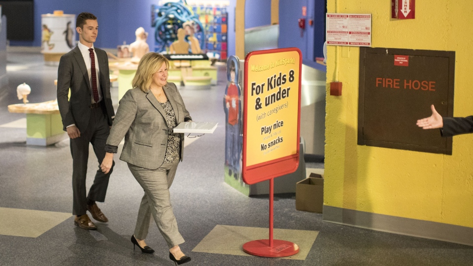 Ontario PC Education Minister Lisa Thompson makes her way to a podium alongside Parliamentary Assistant, Sam Oosterhoff, before making a statement at the Ontario Science Centre in Toronto on Friday, March 15, 2018. THE CANADIAN PRESS/Chris Young