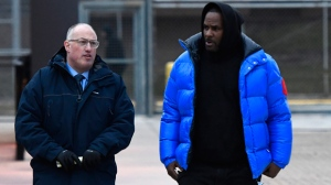 In this Monday, Feb. 25, 2019 file photo, R. Kelly, right, leaves Cook County Jail with his defense attorney, Steve Greenberg, in Chicago. Sex videos like those that have been integral to the criminal cases against R. Kelly have been circulating across the nation for years. Some of the tapes leaked out of the singer's collection in the 1990s. (AP Photo/Matt Marton, File)