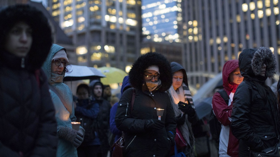 People gather for a vigil in Toronto held for the victims of the New Zealand terror attack on Friday March 15, 2019. Members of Muslim communities across the country offered condolences to the grieving families and spoke out against extremism. THE CANADIAN PRESS/Chris Young