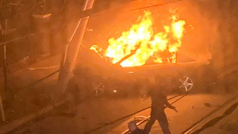 A vehicle burns after striking a light standard on King Street East, near Parliament Street, Sunday March 17, 2019. (@mrriecker/ Twitter)