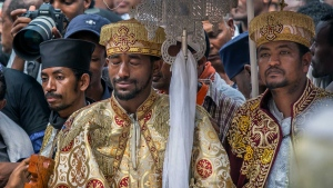 A priest cries at a mass funeral at the Holy Trinity Cathedral in Addis Ababa, Ethiopia Sunday, March 17, 2019. (AP Photo/Mulugeta Ayene)