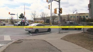 Police tape surrounds a vehicle at an intersection in Mississauga where a pedestrian was struck by a vehicle on March 17, 2019.
