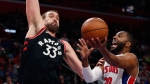 Detroit Pistons guard Wayne Ellington (20) attempts a layup as Toronto Raptors center Marc Gasol (33) defends during the second half of an NBA basketball game, Sunday, March 17, 2019, in Detroit. (AP Photo/Carlos Osorio)