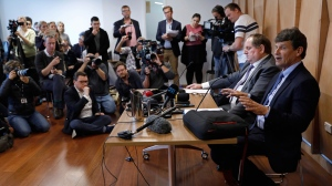 Gun City owner David Tipple, right, speaks during a press conference in Christchurch, New Zealand, Monday, March 18, 2019. The Christchurch gun shop on Monday acknowledged selling guns online to the 28-year-old white supremacist accused of killing 50 people in mosque shootings that have upturned New Zealand's reputation as among the world's most tolerant and safe nations. (AP Photo/Vincent Yu)