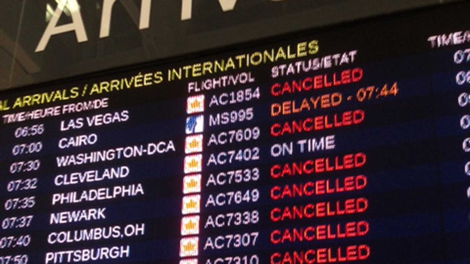 An arrivals board at Pearson International Airport's Terminal 1 shows a number of cancelled and delayed flights Monday March 18, 2019. (Cam Woolley /CP24)