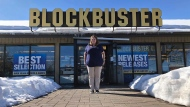 In this Monday, March 11, 2019, photo, Sandi Harding, general manager of the last Blockbuster on the planet in Bend, Ore., poses for a photo outside the store. (AP Photo/Gillian Flaccus)