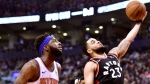 New York Knicks centre Mitchell Robinson (26) looks on as Toronto Raptors guard Fred VanVleet (23) drives to the net during first half NBA basketball action in Toronto, Monday, March 18, 2019. THE CANADIAN PRESS/Frank Gunn