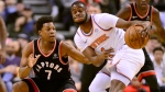 Toronto Raptors guard Kyle Lowry (7) and New York Knicks guard Emmanuel Mudiay (1) vie for control of a loose ball during first half NBA basketball action in Toronto, Monday, March 18, 2019. THE CANADIAN PRESS/Frank Gunn